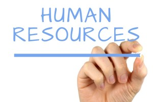 "Photo of a hand writing ""Human Resources"""